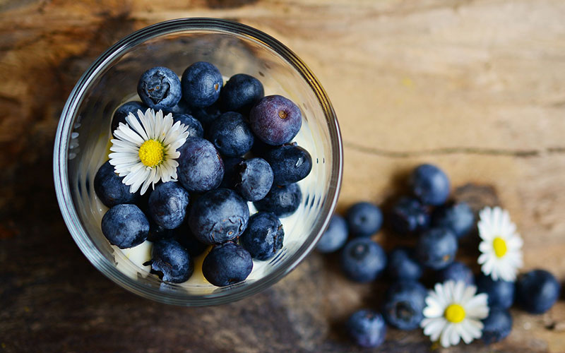 Blueberries in a glass container