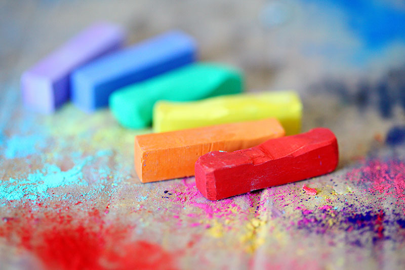 A collection of chalk sticks in every color of the rainbow