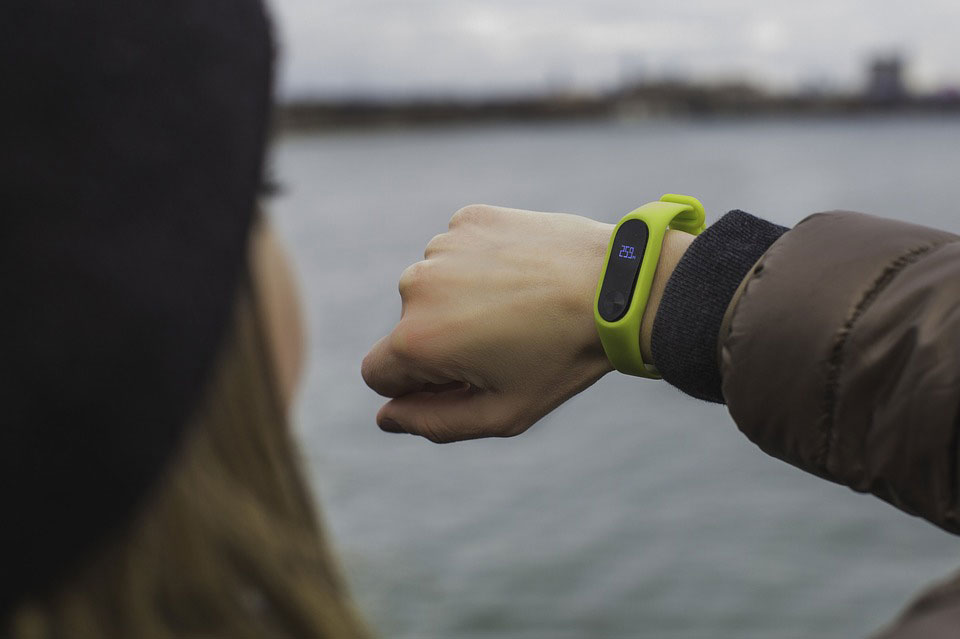 Person looking at smart watch on wrist